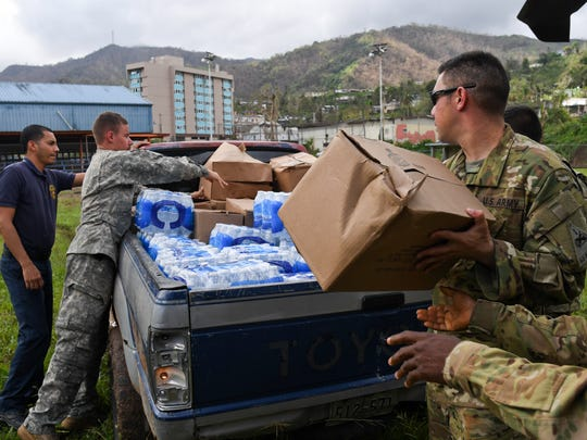Soldiers with the 6th Battalion, 101st General Support Aviation Battalion, 101st Combat Aviation Battalion, 101st Airborne Division (Air Assault) and the 1st Armored Division unload food and water October 11, 2017 in Castaner, Puerto Rico. The Soldiers are supporting FEMA relief efforts after the devastating effects of Hurricane Maria