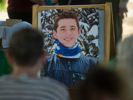 A photo of Samuel Allen, 17, is viewed by family and