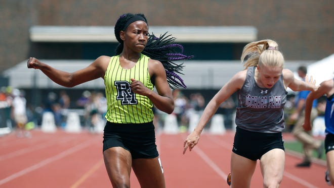 Lanae-Tava Thomas of Rush-Henrietta won the Girls 200 meter run Division 1 followed by Jenna Crean of Orchard Park during the NYSPHSAA Outdoor Track & Field Championships at Cicero-North Syracuse High School.