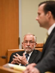 Former MSU dean at the College of Osteopathic Medicine William Strampel, left, listens as his attorney John Dakmak makes his closing arguments to dismiss charges against his client, Tuesday, June 5, 2018, in 54B District Court.