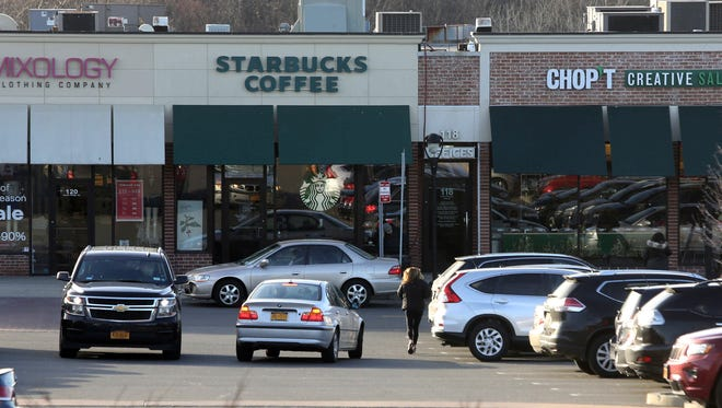 Drivers search for parking spots in the Rye Ridge Shopping Center in Rye Brook.