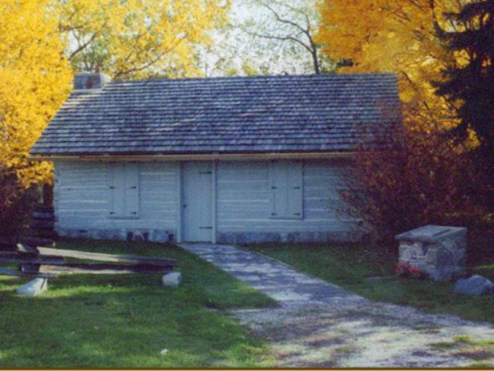 The oldest log cabin in Greenfield stands on the grounds