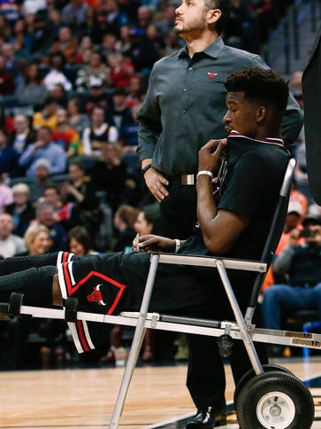 Chicago Bulls guard Jimmy Butler strained his left