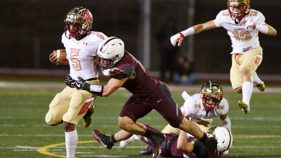 Bergen Catholic at Don Bosco on Friday, October, 27, 2017. BC #5 Josh McKenzie avoids a tackle in the first quarter.