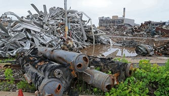 Old machine parts and other scrap metal are piled high around the demolition site at the former General Motors plant in Janesville.  Commercial Development Co. has bought the GM complex, and demolition is in progress.