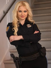 """Hannah Stroh plays rookie cop Mary Honeywell in """"Action Super Squad — Des Moines."""""""