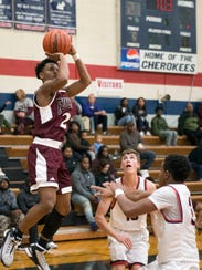 Fulton's Trey Davis attempts to score while being defended