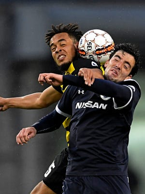 SC Nashville's Tucker Hume, 12, goes after a ball versus Pittsburgh's Thomas Vancaeyezeele, 25, at Nissan Stadium on March 24, in Nashville, Tenn. The game ended with a 0-0 tie.