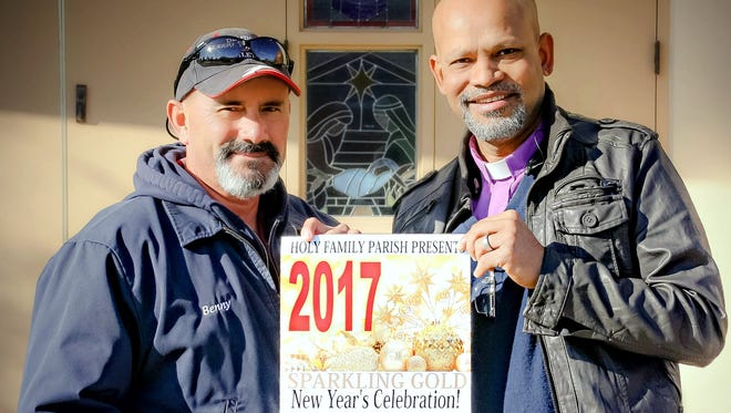 """The Rev. Ron Machado, right, and Deming Mayor Benny Jasso are hanging posters all over town for the annual Holy Family Catholic Parish """"Sparkling Gold"""" New Year's Eve celebration set for 6:30 p.m. to 1 a.m. Dec. 31 at the Mimbres Valley Special Events Center, 2300 E. Pine St. Tickets are $125 per couple and can be purchased at the Holy Family Catholic Parish Administration Office, 615 S. Copper St."""