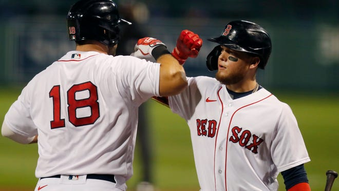 Boston's Mitch Moreland (18) celebrates his two-run homer with Alex Verdugo during the third inning Friday night at Fenway Park.