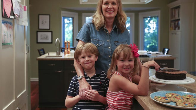 Eileen Gannon stands in her kitchen with her children Helen Hutchison, 7, and Graham Hutchison, 6, on August 6. Gannon said she learned a love for baking and cooking from her mother which she is now passing on to her children.