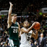 P.J. Thompson drives past Matt McQuaid of Michigan State for a score Tuesday, February 9, 2016, at Mackey Arena. Purdue defeated Michigan State 82-81 OT.