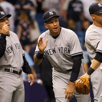 Yankees designated hitter Alex Rodriguez (13), second