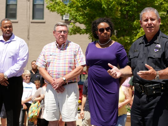 Oshkosh Police Chief Dean Smith talks and stands with Tracey Robertson Executive Director of Fit Oshkosh, Mayor Steve Cummings and Pastor Joe Butler as he addresses the community before the walk.  The Oshkosh Unity Walk involving Oshkosh Police, UW-Oshkosh Police, Oshkosh Fire Department, Community leaders and members of the community.  They met downtown at the sundial and walked both sides of Main Street back to the sundial.  Over 200 people participated in the walk Friday July 8, 2016.Joe Sienkiewicz / USA TODAY NETWORK-Wisconsin