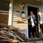 """Courtney Morely, 24, moved back to Louisville one year ago after graduating from Western Kentucky University. """"I've always loved Germantown,"""" Morely said as she ripped down plaster wall in her father's cowboy boots. """"It has always been a place that I've wanted to live in.""""   After working a full day, Morely and her father gutted the house that once belonged to her grandfather. They  hope to have the rental property in a working condition by August. Morely, like other millennial home owners in Germantown, has decided to move into the area because the cost of living is affordable and the location is hard to beat."""