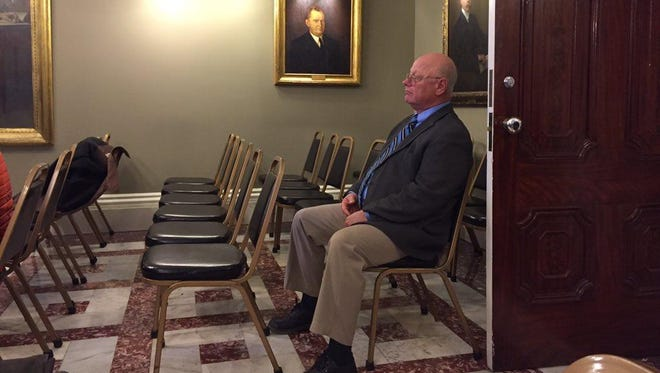Sen. Norm McAllister attends Wednesday's Rules Committee hearing in Montpelier during which members voted to recommend to the full Senate that lawmakers suspend the Franklin County Republican while criminal sex charges are pending against him.
