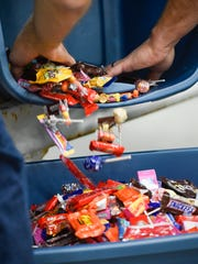 Almost 2 tons of candy is distributed to the games
