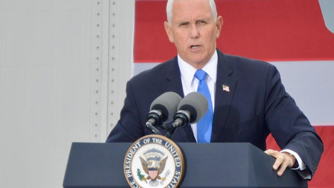"""Vice President Mike Pence speaks to the crowd at the """"Make America Great Again,"""" rally Wednesday, Oct. 14, 2020, in Grand Rapids, Mich."""