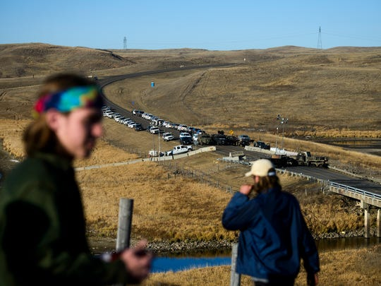 Two Dakota Access Pipeline protesters overlook a law