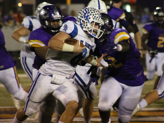 St. Mary's quarterback Aaron Howell runs against the