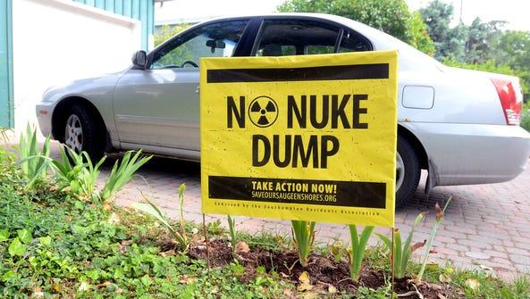 An anti nuke dump poster sits in a yard in Kincardine,
