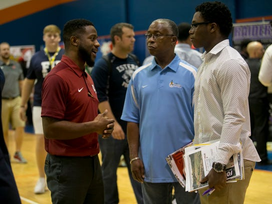 Alex Suber of Lyon College talks with Rickey Anderson