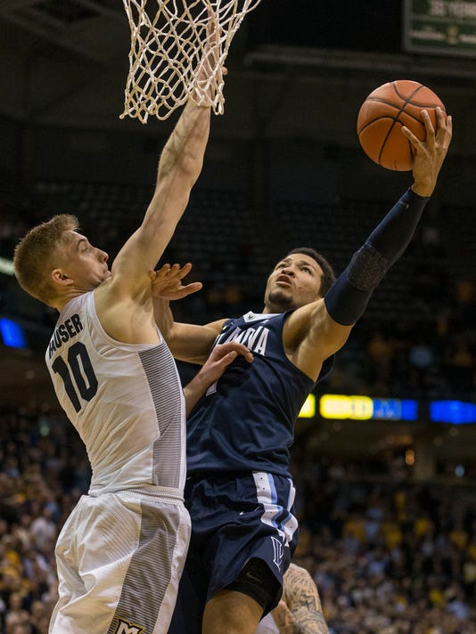 Marquette's Sam Hauser defends against Villanova's Jalen Brunson as he takes the last second shot during the second half of an NCAA college basketball game Tuesday, Jan. 24, 2017, in Milwaukee. Marquette defeated Villanova 74-72. (AP Photo/Tom Lynn)