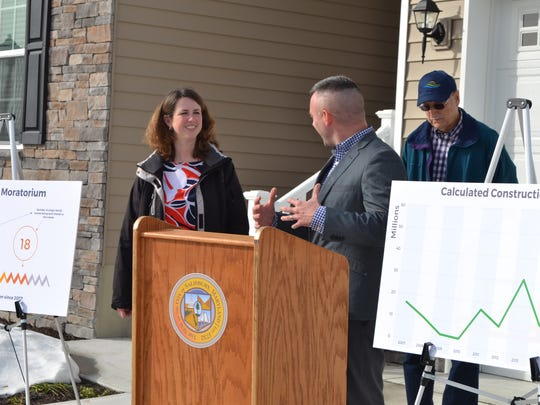 Salisbury Mayor Jake Day, right, announces that 2017 was the city's best year for new and infill construction since 2007. With him are Amanda Pollack, director of the Department of Infrastructure and Development, and City Council President Jack Heath in back.