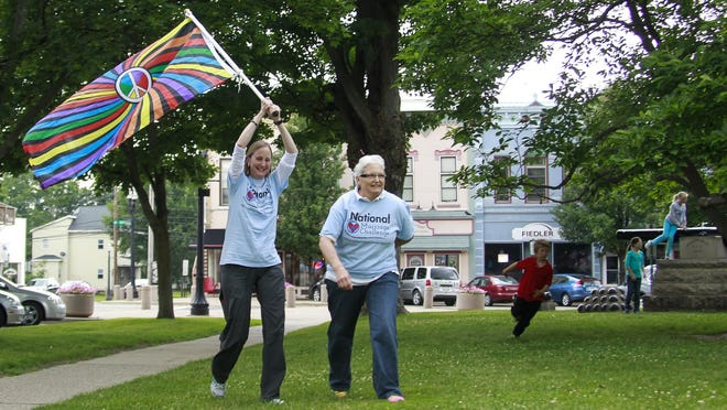 Glenna DeJong, left, and Marcia Caspar, celebrate with supporters of same-sex marriage Friday evening at the Ingham County Courthouse in Mason. They were Michigan's first same-sex couple to marry last March.