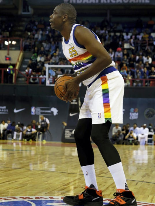 Team Africa's NBA legend Dikembe Motumbo takes a shot during the NBA Africa Game at Ellis Park Arena in Johannesburg, South Africa, on Saturday.