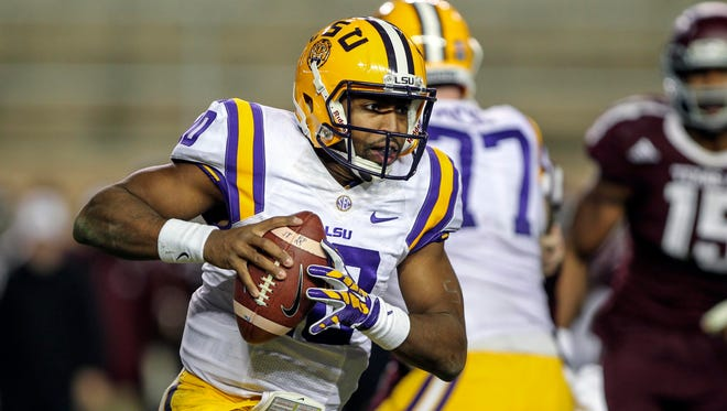 LSU Tigers quarterback Anthony Jennings (10) runs with the ball on a keeper during the fourth quarter against the Texas A&M Aggies at Kyle Field. The Tigers defeated the Aggies 23-17. Charges will not be filed against Jennings and two other players regarding an on-campus break in