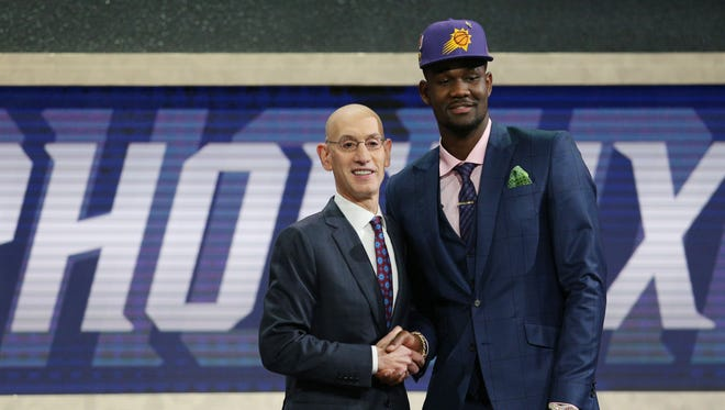 Deandre Ayton of Arizona greets NBA commissioner Adam Silver after being selected No. 1 overall in the NBA draft by the Phoenix Suns on June 21, 2018.