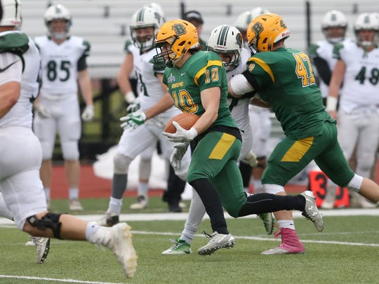 Brockport's defensive back Jake O'Connell, 10, runs his interception in for a touchdown in the second quarter giving Brockport a 24-0 lead over Plymouth State during their NCAA Division III Football Championship first round playoff game Saturday, Nov. 18, 2017 at the College at Brockport.  Brockport won 66-0.