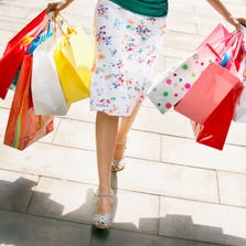Woman holding shopping bags.