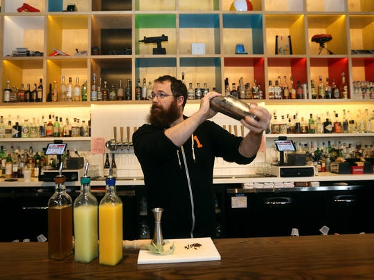Dan Brennan, a bartender at Playhouse Swillburger, created a mocktail called a citrus spice cooler and  includes muddled sage and cloves.