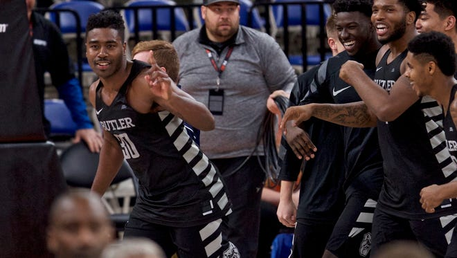 Butler forward Kelan Martin, left, reacts after making the game winning basket during overtime of an NCAA college basketball game against Ohio State in the Phil Knight Invitational tournament in Portland, Ore., Sunday, Nov. 26, 2017.