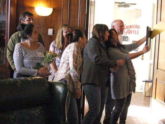 AgKnowledge graduates examine their group photo.