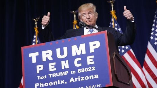 Republican presidential candidate Donald Trump gives two thumbs up while speaking to a crowd at the Phoenix Convention Center on Aug. 31, 2016.