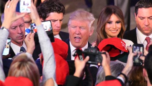 President-elect Donald Trump greets supporters on election night.