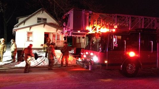 Fire crews respond to Muskegon Heights house fire.