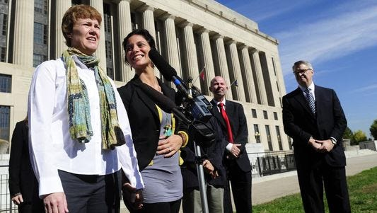 Sophy Jesty, left, and Valeria Tanco speak outside the Davidson County Courthouse in October 2013 after joining a suit that aimed to force Tennessee to recognize same-sex marriages. On Thursday the Sixth Circuit Court of Appeals upheld the state's ban.