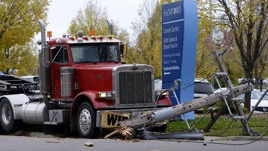 A semi-trailer collided with a power pole at 17th Street and Lake Avenue near Sanford Health Hospital on Friday, Oct. 17, 2014.