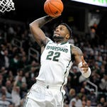 Kevin W. Fowler/for the Lansing State JournalMSU's Branden Dawson continues to lead the Big Ten in rebounding, averaging 10.0 for the season and 11.0 in conference games. MSUâ??s Branden Dawson (22) will return for his senior season. Kevin W. Fowler/For the LSJ MSU?s Branden Dawson (22) makes a short jumper over Minnesota?s Andre Hollins. Dawson finished with seven points. Kevin W. Fowler/For the LSJ Branden Dawson (22) of MSU knocks down a short jumper over Andre Hollins (left) of Minnesota to begin scoring in the 1st half of their game Wednesday February 6, 2013 in East Lansing. KEVIN W. FOWLER PHOTO