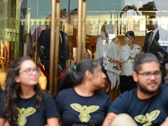 Members of Movimiento Cosecha block the entrance of Trump Tower in Manhattan last summer while chained together.