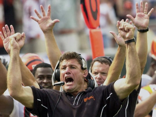 Former Cincinnati Bengals defensive tackle and coach Tim Krumrie coach reacts after the Bengals defense sack New England Patriots Drew Bledsoe to end the game and give the Bengals a 23-16, in September 2001.