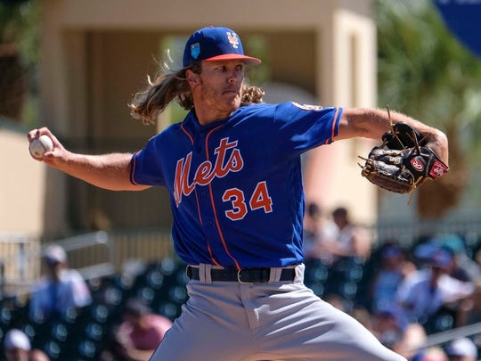 Noah Syndergaard fires a pitch Saturday against Miami.