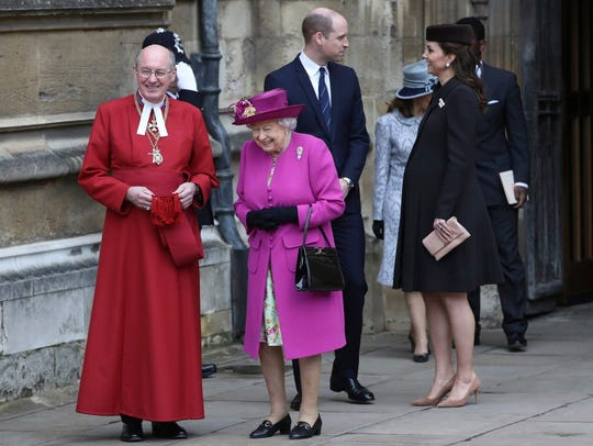 Britain's Queen Elizabeth II (in bright pink) with