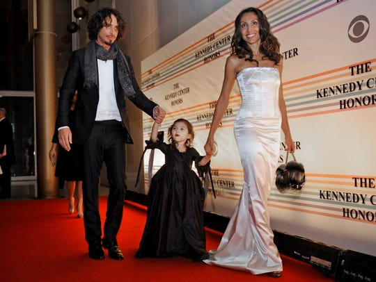 Chris Cornell, left, with his daughter Toni and wife