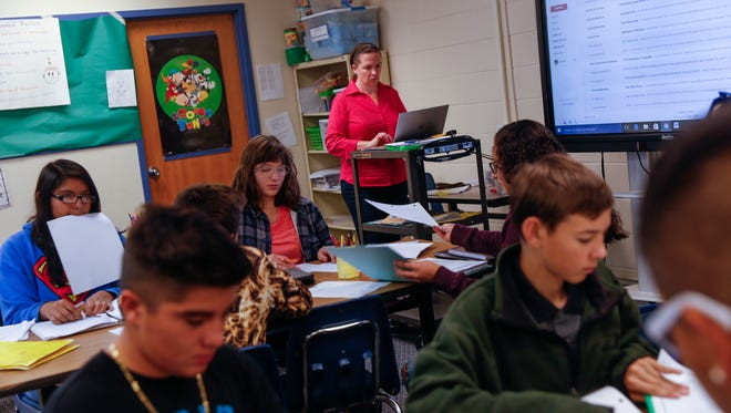 Math teacher Jennifer Augustine prepares for the day's instruction Thursday at Mesa Alta Junior High School in Bloomfield.