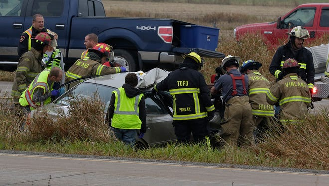 Emergency crews respond to a crash involving a large truck and car about 1:15 p.m. Thursday, Nov. 2, 2017, on U.S. 45 North at Winnebago County T. The truck flipped on its side in the median, and there was heavy damage to the car.